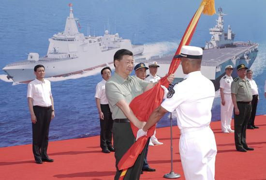 Xi attends commissioning of Chinese naval vessels