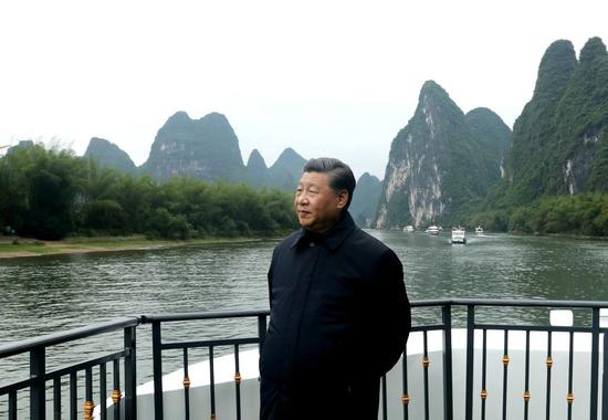 Xi Jinping visits a section of the Lijiang River and learns about local efforts in the ecological conservation of the river in Yangshuo, south China's Guangxi Zhuang Autonomous Region, April 25, 2021.  (Xinhua/Ju Peng)