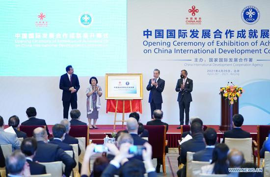 Chinese State Councilor and Foreign Minister Wang Yi attends the opening ceremony of Exhibition of Achievements on China International Development Cooperation and delivers a speech in Beijing, capital of China, April 26, 2021. (Xinhua/Li Xiang)