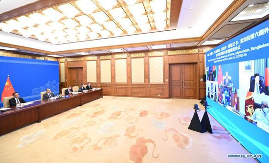 Chinese State Councilor and Foreign Minister Wang Yi chairs a video conference of Foreign Ministers of China, Afghanistan, Bangladesh, Nepal, Pakistan and Sri Lanka on coping with COVID-19, April 27, 2021. (Xinhua/Li Xiang)