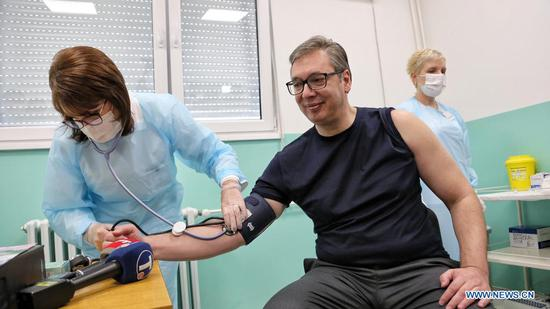 Serbian President Aleksandar Vucic checks blood pressure before receiving the second dose of the Chinese Sinopharm vaccine in Doljevac, Serbia, April 27, 2021. Serbian President Aleksandar Vucic on Tuesday received the second dose of the Chinese Sinopharm COVID-19 vaccine here in southeastern Serbia and expressed gratitude to China and the Chinese people for