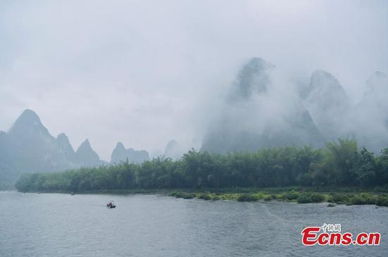 Misty rain shrouds Lijiang River