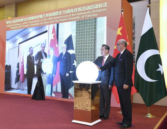 Chinese State Councilor and Foreign Minister Wang Yi attends a virtual ceremony with Pakistani Foreign Minister Shah Mahmood Qureshi to formally commence the celebrations of the 70th anniversary of diplomatic relations between the two countries in Beijing, China, March 2, 2021. (Xinhua/Rao Aimin)