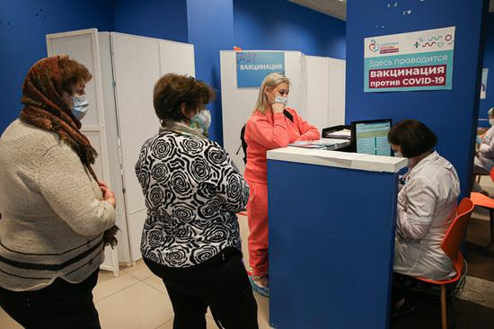 Putin says 21.5 mln Russians vaccinated against COVID-19