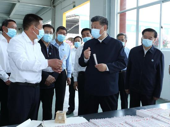 Chinese President Xi Jinping, also general secretary of the Communist Party of China Central Committee and chairman of the Central Military Commission, visits a local company producing mugwort products, inspecting how Nanyang uses the herb to develop its specialty industries, create more jobs and boost local employment, in Nanyang, central China's Henan Province, May 12, 2021. Xi Jinping on Wednesday inspected the city of Nanyang in Henan Province. (Xinhua/Ju Peng)