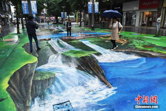 Nature and ecology themed 3D pavement painting displayed in Chongqing