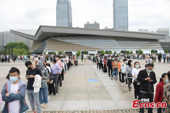 People line up for COVID-19 vaccination in Feixi, Hefei
