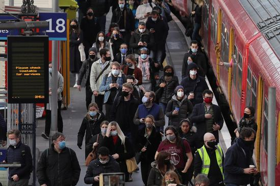 Commuters arrive in the morning rush hour at London Waterloo train station in London, Britain, on April 9, 2021. (Xinhua/Tim Ireland)
