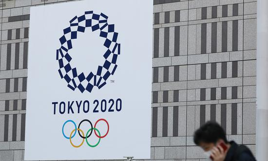 IOC chief, Japanese PM promise Tokyo Olympics to be held safely