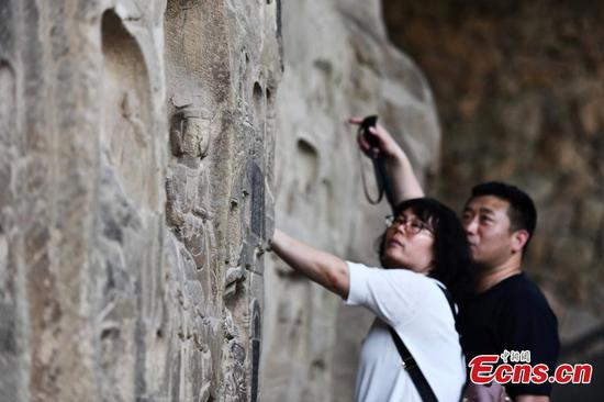 1,500-year-old 'national treasure': Gongyi Grotto Temple wows tourists