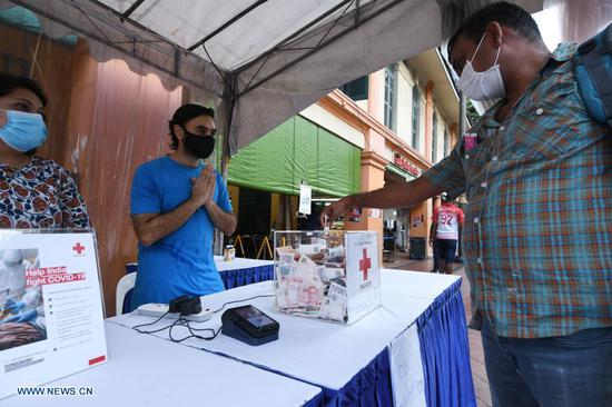 India's COVID-19 tally nears 27 mln, daily cases and deaths fall
