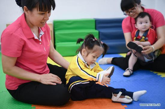 China's orphan population declines by 66 percent
