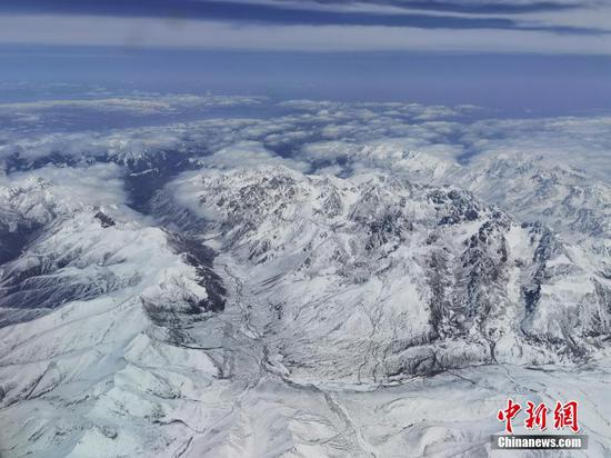 Snow blankets Qilian Mountains in early summer