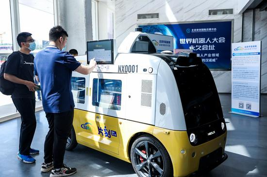 Unmanned delivery vehicles to hit Beijing roads