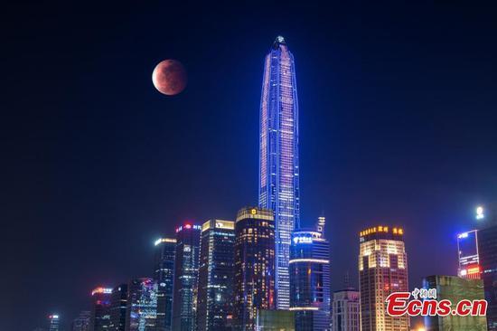 Spectacular lunar eclipse & super blood moon appear across the world