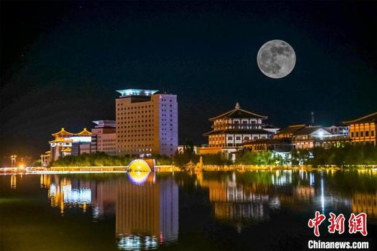 Supermoon hangs over Chinese ancient city Dunhuang