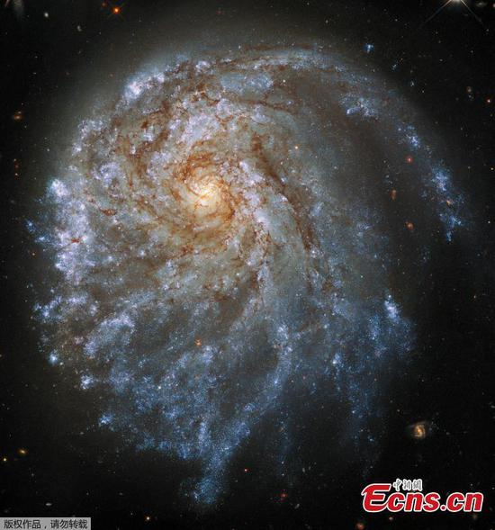Hubble releases striking image of spiral galaxy