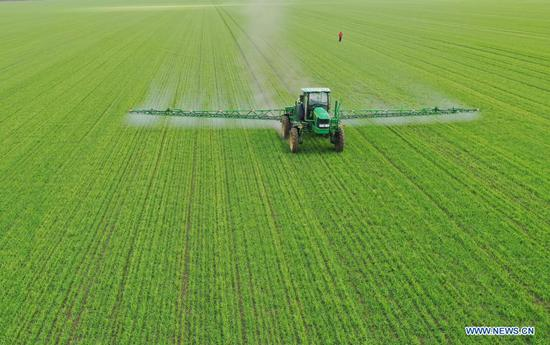 Self-propelled sprayer at work on farm in Heilongjiang