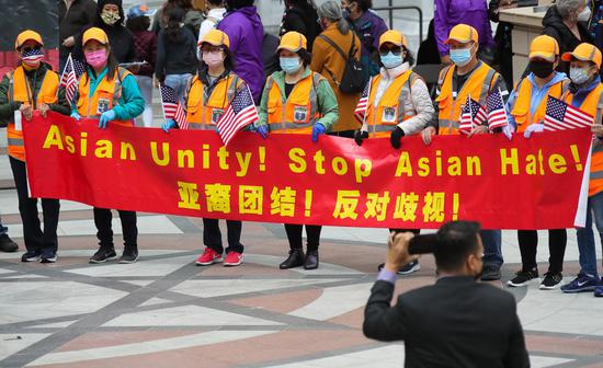 People holding a bilingual banner take part in a Stop Asian Hate rally in Oakland, San Francisco Bay Area, the United States, May 15, 2021. (Photo: Xinhua/Dong Xudong)