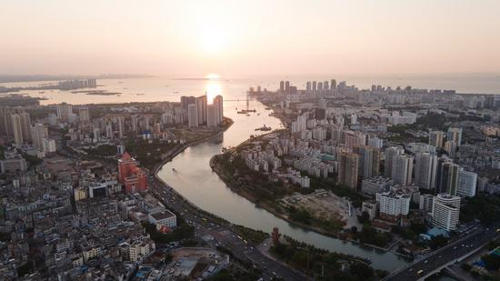 Aerial photo taken on May 4, 2021 shows the city view in Haikou, capital of south China's Hainan Province. Haikou is a core city for the construction of free trade port in Hainan Province. (Xinhua/Zhang Liyun)