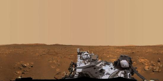 This 360-degree panorama photo taken by NASA's Perseverance rover shows ''Van Zyl Overlook,'' where the Ingenuity helicopter performs its first flights on Mars. It is made up of 992 individual images stitched together, which are taken between April 15 and April 26, 2021. (Photo credit: NASA)