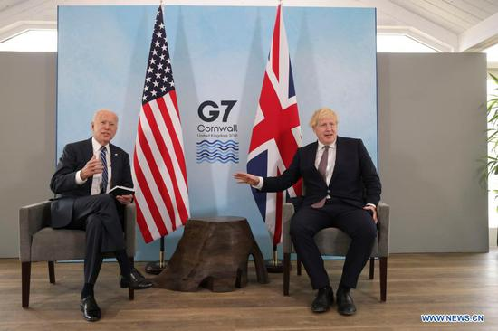 British Prime Minister Boris Johnson (R) meets with U.S. President Joe Biden in Carbis Bay, Cornwall, Britain, on June 10, 2021. Boris Johnson and Joe Biden on Thursday agreed to work to resume travel between the two countries and signed a new Atlantic Charter, as they met ahead of the Group of Seven (G7) summit. (Andrew Parsons/No 10 Downing Street/Handout via Xinhua)