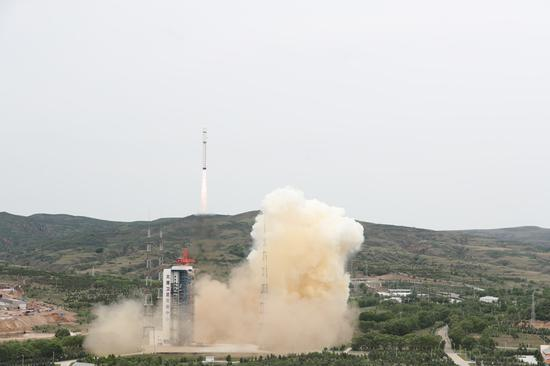 China launches four satellites in one rocket