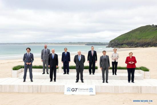 (From L to R, Front) Canadian Prime Minister Justin Trudeau, U.S. President Joe Biden, British Prime Minister Boris Johnson, French President Emmanuel Macron, German Chancellor Angela Merkel, (From L to R, Rear) European Council President Charles Michel, Japanese Prime Minister Yoshihide Suga, Italian Prime Minister Mario Draghi, and European Commission President Ursula von der Leyen, stand for a family photo during the Group of Seven (G7) Summit in Carbis Bay, Cornwall, Britain, on June 11, 2021. The first in-person G7 summit kicked off on Friday in Britain's southwestern resort of Carbis Bay in almost two years. (Andrew Parsons/No 10 Downing Street/Handout via Xinhua)