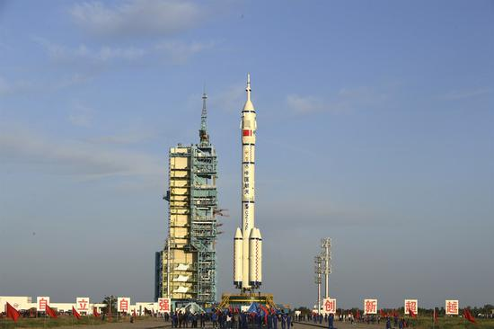 Photo shows the combination of the Shenzhou-12 manned spaceship and a Long March-2F carrier rocket after it was transferred to the launching area of Jiuquan Satellite Launch Center in northwest China, June 9, 2021. (Photo by Wang Jiangbo/Xinhua)