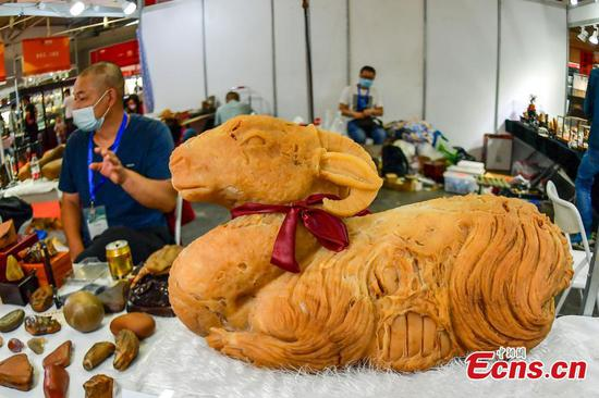 Unique-shaped stones debut at exhibition in China's Xinjiang