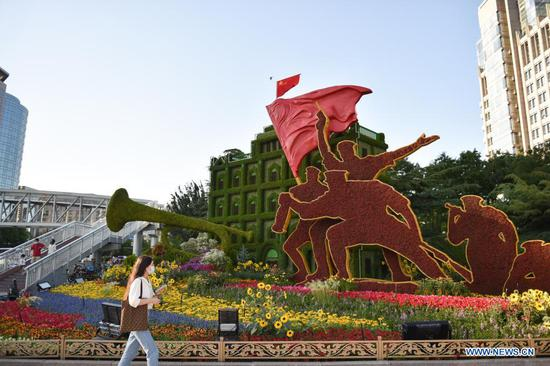 Flower decorations set up along Chang'an Avenue in Beijing