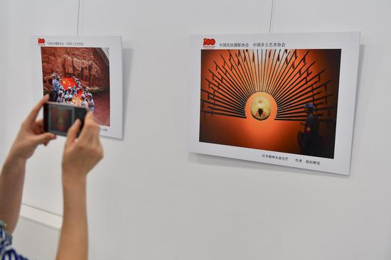 Photo exhibition celebrating 100th anniversary of founding of CPC held in Beijing
