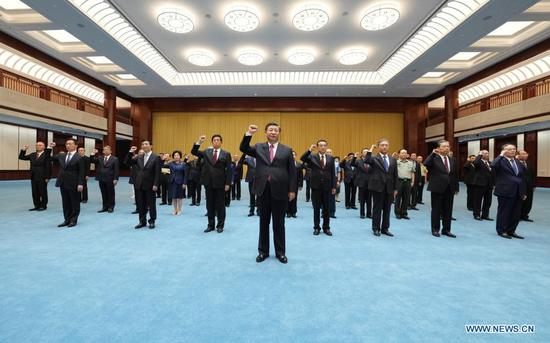 Xi Jinping leads other Communist Party of China (CPC) and state leaders Li Keqiang, Li Zhanshu, Wang Yang, Wang Huning, Zhao Leji, Han Zheng and Wang Qishan to review the Party admission oath after visiting an exhibition on CPC history themed