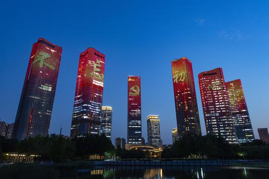 High-rise buildings in Beijing light up for July 1