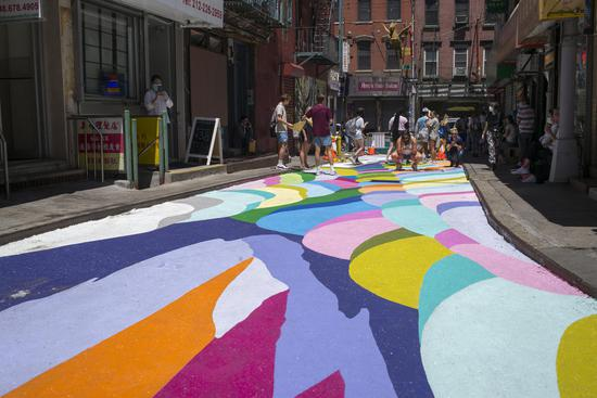 Painted pavements in New York's Chinatown attract visitors