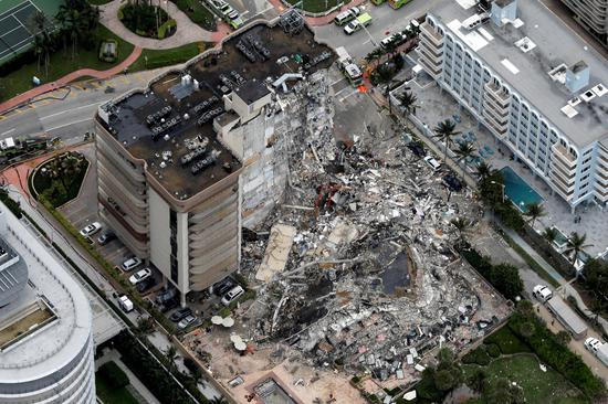 At least 99 missing in Surfside high-rise collapse