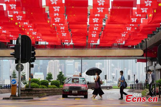 Flags adorn streets in HKSAR to celebrate 24th anniversary of return
