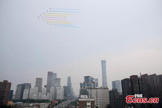 Military aircraft fly over Beijing in echelons to mark CPC centenary