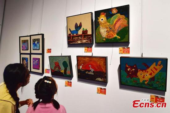 Pupils add creative elements to Fuzhou lacquerwares