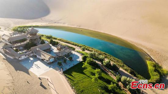 Plants by Crescent Lake turn greener after rain in Dunhuang