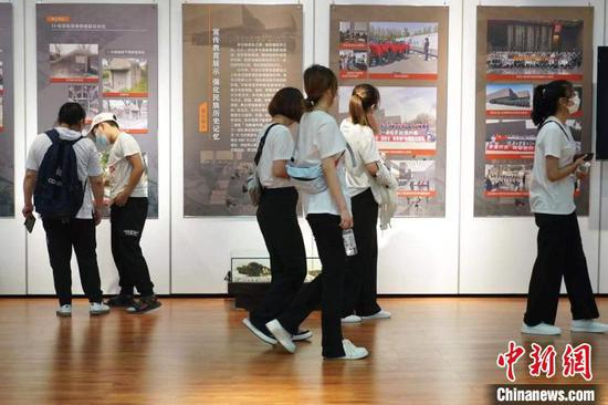 People visit the exhibition about the conservation achievements of Unit 731 in Harbin, Northeast China's Heilongjiang Province. (Photo: China News Service/Lu Pin)
