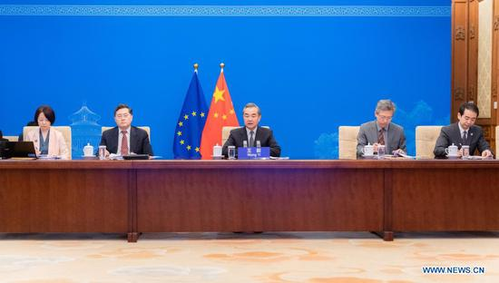 Chinese State Councilor and Foreign Minister Wang Yi speaks during a video meeting with EU High Representative for Foreign Affairs and Security Policy Josep Borrell, in Beijing, capital of China, July 8, 2021. (Xinhua/Zhai Jianlan)