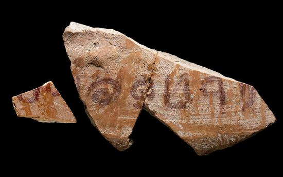 Photo shows the 3,100-year-old biblical inscription found at the archaeological site Khirbet ar-Ra'i near the modern city of Kiryat Gat in southern Israel. (Photo by the Israel Antiquities Authority)