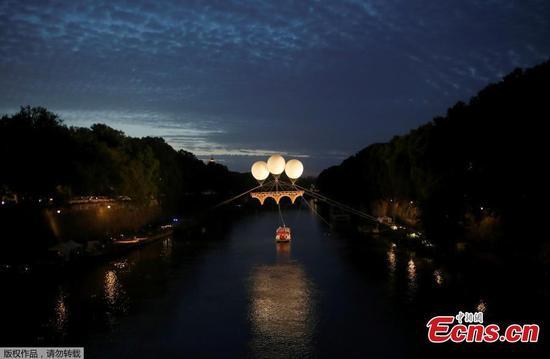 Michelangelo-inspired bridge floats above Rome's Tiber river