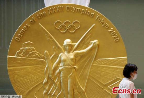 Huge reproduction of Tokyo Olympic medal displayed in Tokyo tower
