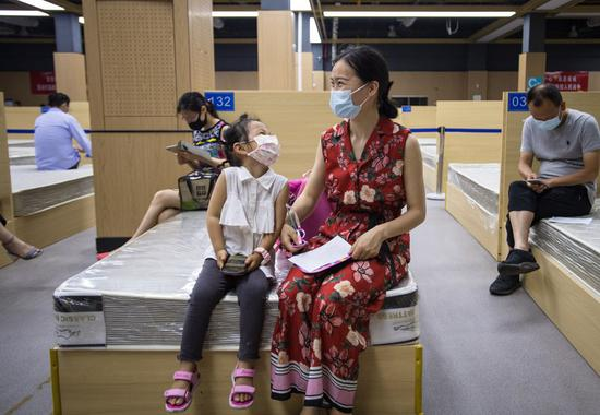 People stay for observation after receiving COVID-19 vaccines at a vaccination site in Jiangxia District in Wuhan, central China's Hubei Province, June 9, 2021. (Xinhua/Xiao Yijiu)