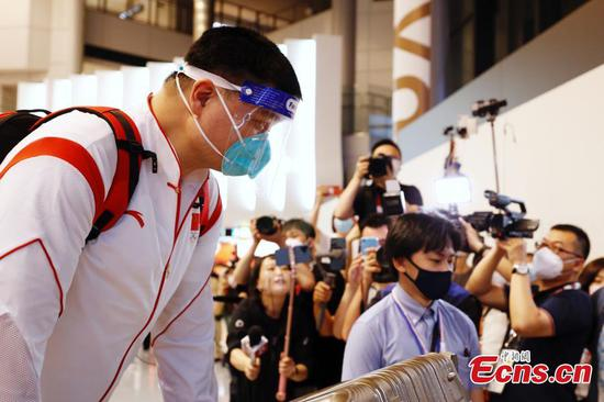 Members of Chinese sports delegation arrive in Tokyo