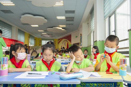 Children have class at a daycare classroom at Qinyuanlu Community of Wuhan, central China's Hubei Province, July 5, 2021. (Photo by Wu Zhizun/Xinhua)