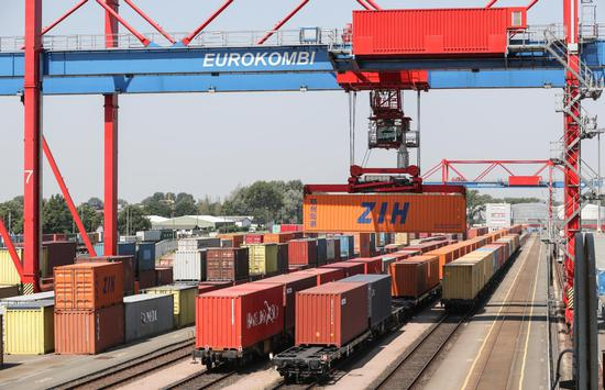 A tower crane unloads containers from a China-Europe rail freight train at the Port of Hamburg, Germany, in 2018. (Photo/Xinhua)