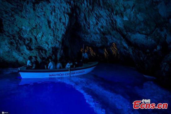 People boat-visit mystery Blue Grotto in Croatia's Bisevo